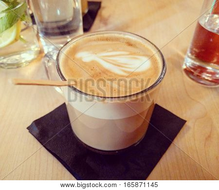 Fancy looking Latte with flower in restaurant