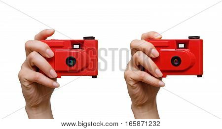 Camera in a hand isolated on white