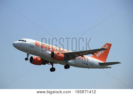 Amsterdam The Netherlands - June 12 2015: G-EZFF easyJet Airbus A319-111 takes of from Amsterdam Airport Polderbaan runway.