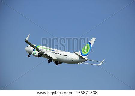 Amsterdam The Netherlands - June 12 2015: PH-HSI Transavia Boeing 737-800 takes of from Amsterdam Airport Polderbaan runway.