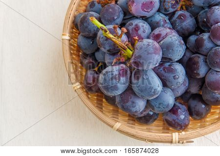 Fresh grapes are in the basket .