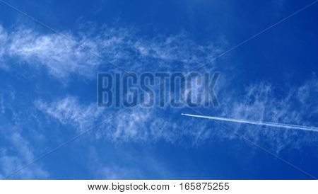Blue sky / Cloud is a visible mass of condensed water vapor floating in the atmosphere, typically high above the ground.