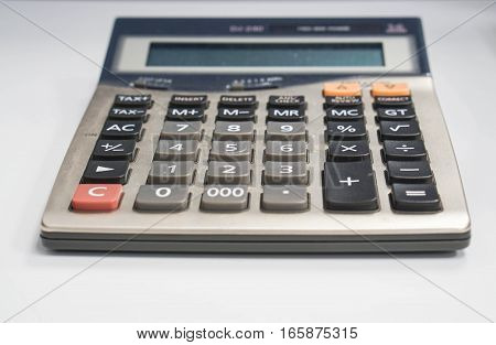 close up calculator on table with selective focus