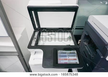 modern printer screen with glass plate in office