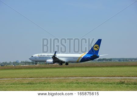 Amsterdam The Netherlands - June 12 2015: UR-PSG Ukraine International Airlines Boeing 737-800 takes off at Amsterdam Airport Schiphol Polderbaan runway. Ukraine International Airlines CJSC is the flag carrier and the largest airline of Ukraine
