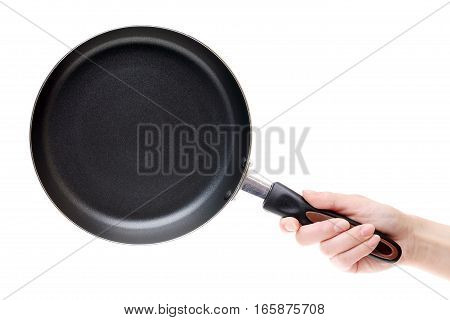 Hand holding frying pan isolated on a white background