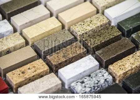 Color samples of natural stone for interior of a modern kitchen. Natural granite countertop