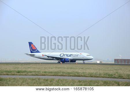 March 24th 2015 Amsterdam Schiphol Airport TC-OBS Onur Air Airbus A320-200 landing on Polderbaan Runway