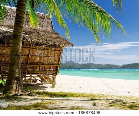 Bamboo hut on a tropical beach. Amazing view of beautiful sea and blue sky.