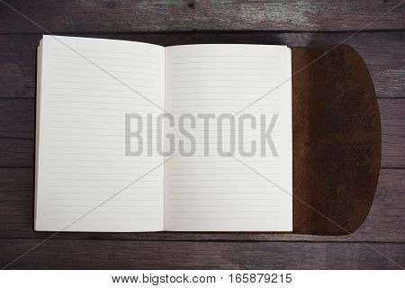 Classic Leather Bound Journal Book Fully Open on a Old Barn Board Floor