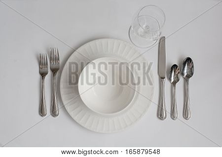 Formal Dinner Place Setting Utensils with White Wine Glass