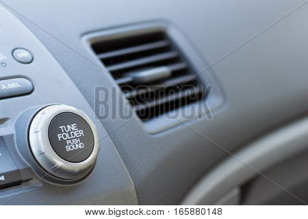 Vehicle Air Vent Opened On Passenger Side Showing Partial Dashboard