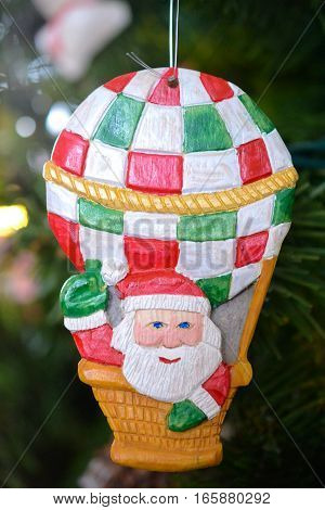 Wooden Santa Claus In A Balloon Christmas Ornament On A Tree