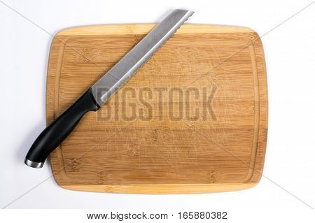 Wooden Cutting Board with Bread Knife Isolated on White