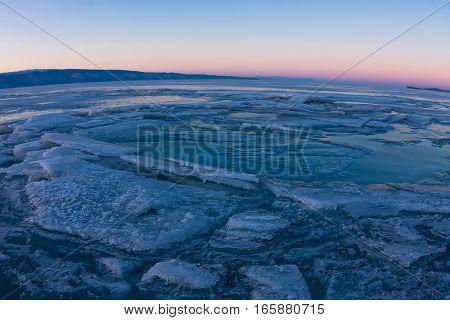 Textured Tile Blue Ice Hummock Of Lake Baikal At Sunset. Olkhon Island