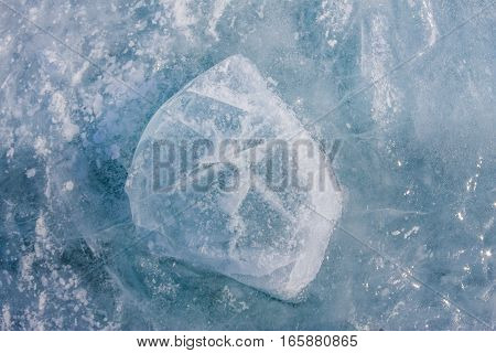 Ice Block Covered With Cracks Texture On The Lake
