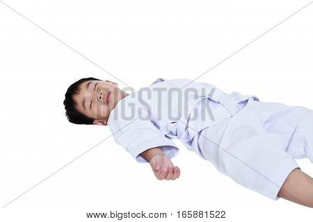 Unconscious boy lying on floor. Asian child athletes taekwondo lying down unconsciously on floor, on white background. Boy with white belt. Studio shot.