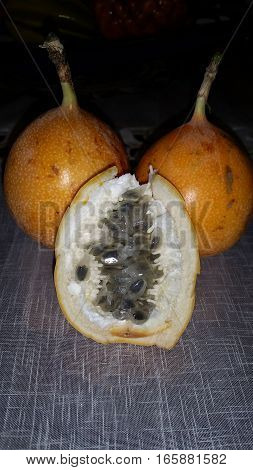 Sweet Granadilla (Passiflora liguralis Just) also known as Chinese pomegranate is commonly found in Mexico and central America. It is similar in texture and flavor to a passionfruit
