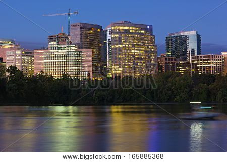 City suburb near Potomac River at dawn in Washington DC USA. Urban skyline with colorful reflections before the sunrise.