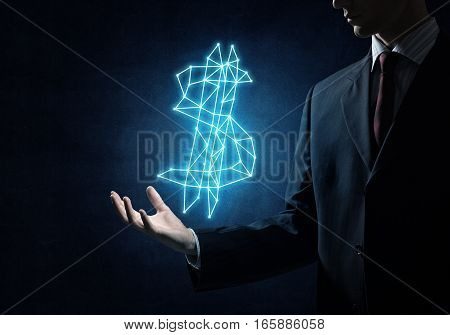 Close of businessman hand showing in palm glowing dollar sign