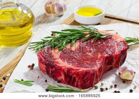 Raw Beef Rib Eye Fresh Meat Steak On Chopping Board