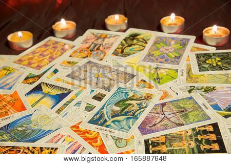 Moscow, Russia - December 4, 2016: Tarot card Knight of Cups with other cards. Thoth tarot deck. Esoteric background