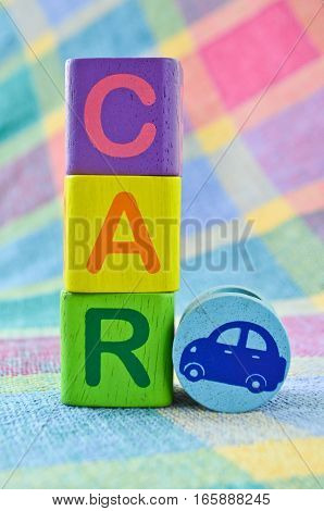 Closeup wooden alphabet blocks in a word CAR