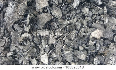 Natural coals texture. Black coals abstract texture