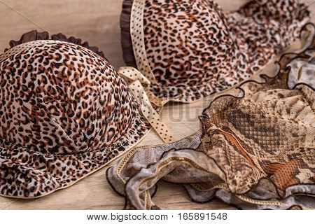 cowards and bra of leopard on wooden table