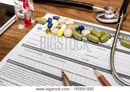 medical form with syringe different medicaments doctor's stethoscope