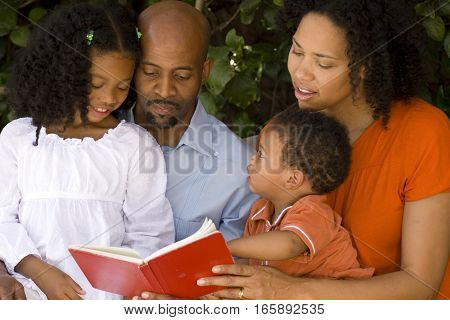 Happy African American parents and their children.