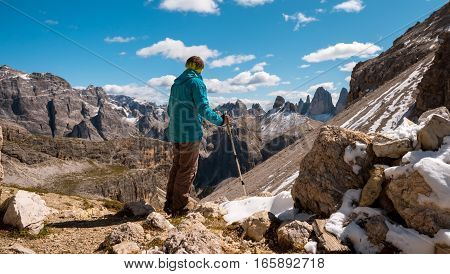 Hiker enjoying view from top of mountain, Dolomites, Italy