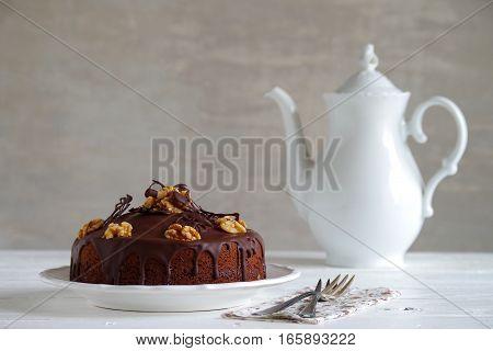 homemade chocolate cake with chocolate glazing and walnut
