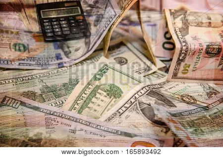 us dollar with tax form, pen and calculator