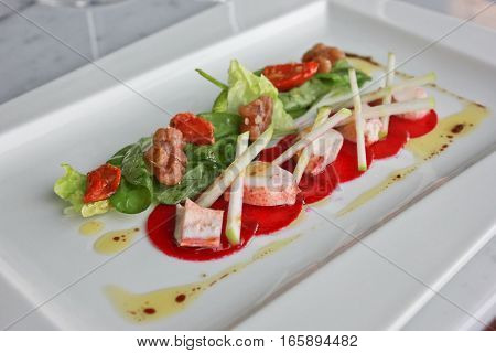 Lobster salad with fresh vegetable and olive oil