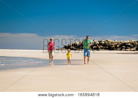 Grandmother with grandson having fun on the beach