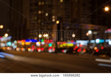 Blurred urban traffic background scene at night