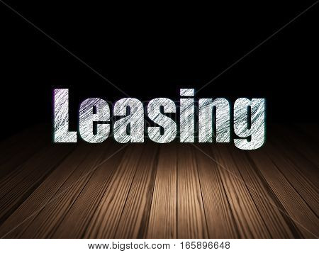 Business concept: Glowing text Leasing in grunge dark room with Wooden Floor, black background