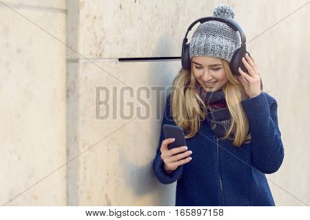 Woman Enjoying The Music In Wireless Headphones