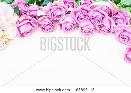 Valentines day violet roses top view flat ly border with copy space