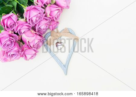 Valentines day violet roses top view flat lay scene with heart