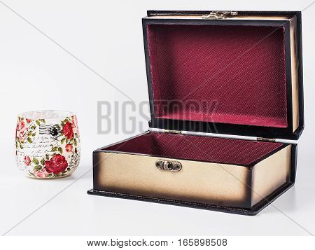 Picture of opened wooden jewel-box with red fit-out and decoupage glass on white background. Handmade boxes for bijouterie. Side view.