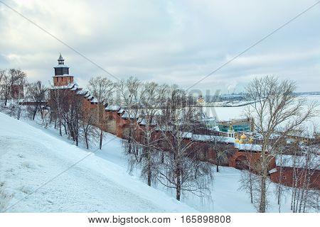 RUSSIA NIZHNY NOVGOROD January 18 2016: Tainitzkaya tower of Nizhny Novgorod Kremlin with view of Volga river in snow weather