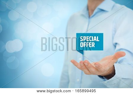 Special offer, business model and marketing offer concept. Businessman hold virtual label with text special offer, bokeh on background.