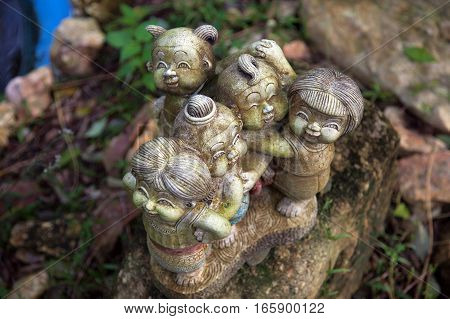 Stone figures in the grass in the park