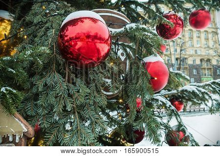 colorful balloons and decorations on the Christmas tree