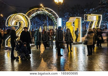 MOSCOW, RUSSIA - January 14, 2017: People and tourists walk along Moscow decorated for New Year and Christmas holidays. Christmas village fair on Tverskaya street in the Moscow