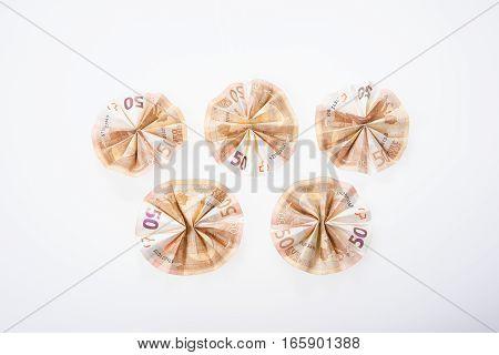 Five fifty euro bills folded in circular shape
