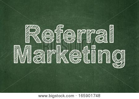 Marketing concept: text Referral Marketing on Green chalkboard background