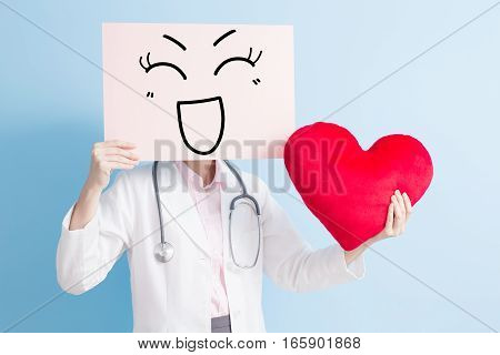 woman doctor take smile billboard and heart isolated on blue backgorund asian